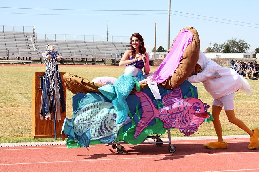 Brianna, inside an oyster,  pushed by a pelican during the Homecoming Cart contest.