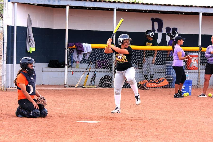 Softball team practice their hitting.