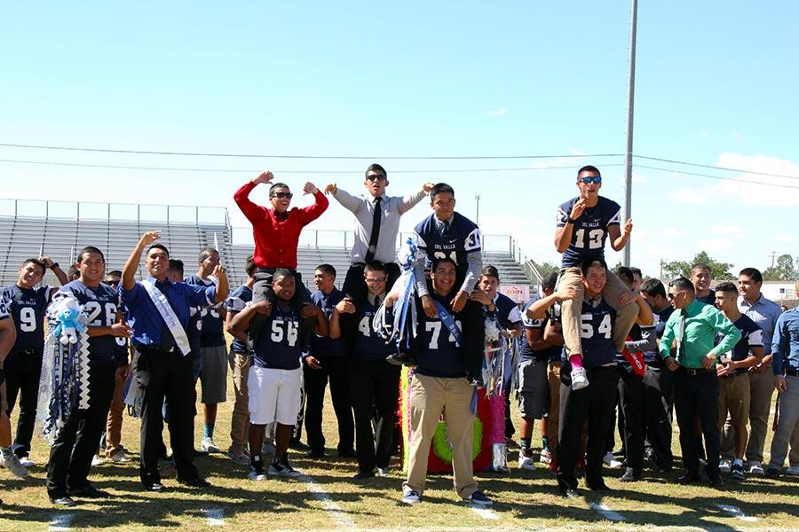 The+varsity+football+team+at+the+Homecoming+pep+rally.