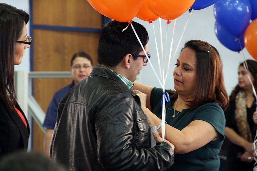 Ricardo gets his pin from Principal Crosse