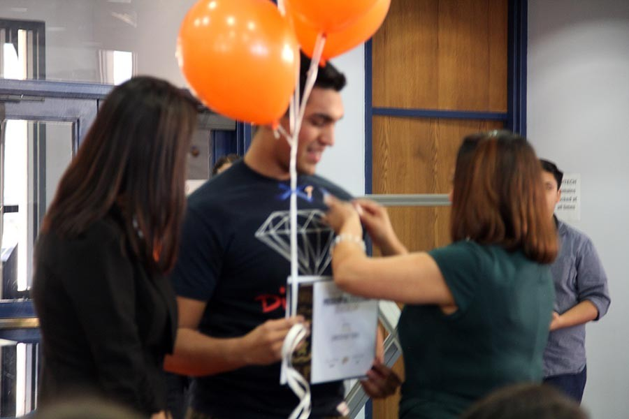 Christopher receives pin from Ms.Crosse