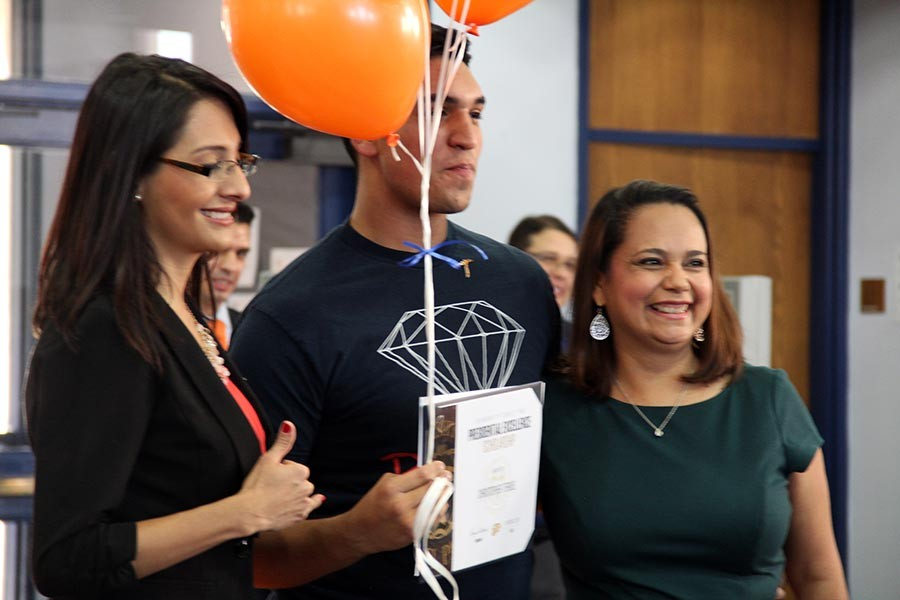 Christopher receives his scholarship.