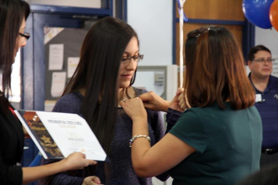 Keren receives pin from Principal Crosse.