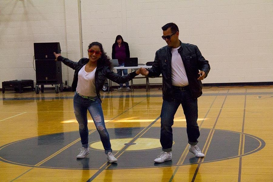 Karen and English teacher Pedro Espinoza take the big win.
