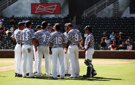 The varsity baseball team huddles at Southwest University Park at the game against Bel Air. The boys won 3-0, April 18.