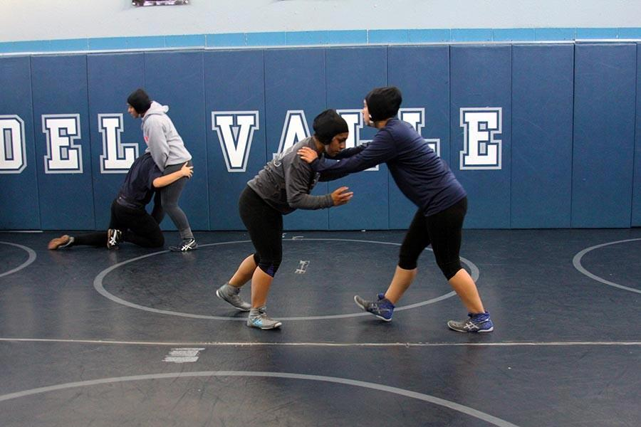 Wrestling ladies practice for a  match.