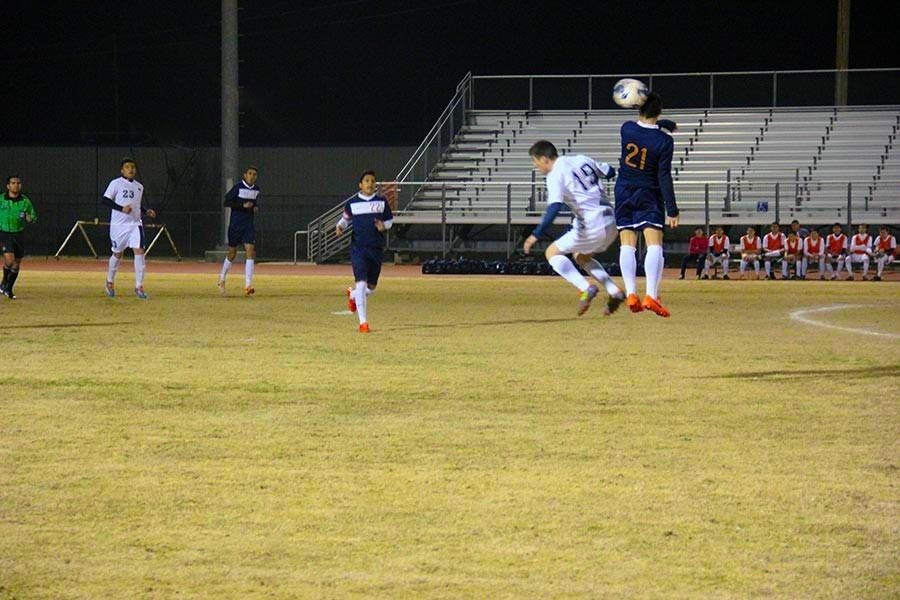 Soccer varsity boys going after it.
