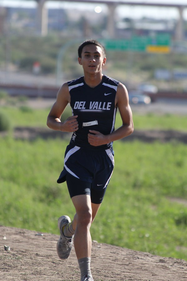 Cross country runner Manny focuses on finishing the saturday August 29 competiton at Del Valle.