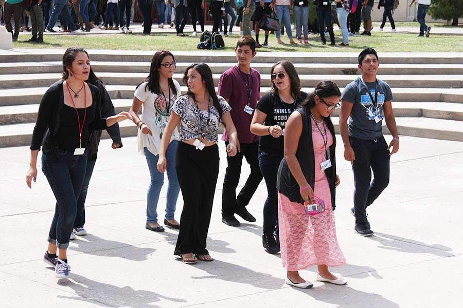 Students dance to the music.
