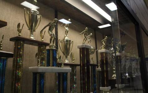 The swim team's Border Invitational trophies range from 1992 to 2012.