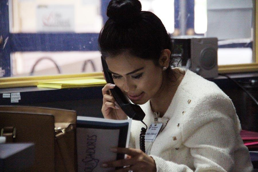 Senior Isabel Gonzalez works her shift at the  front desk on campus.