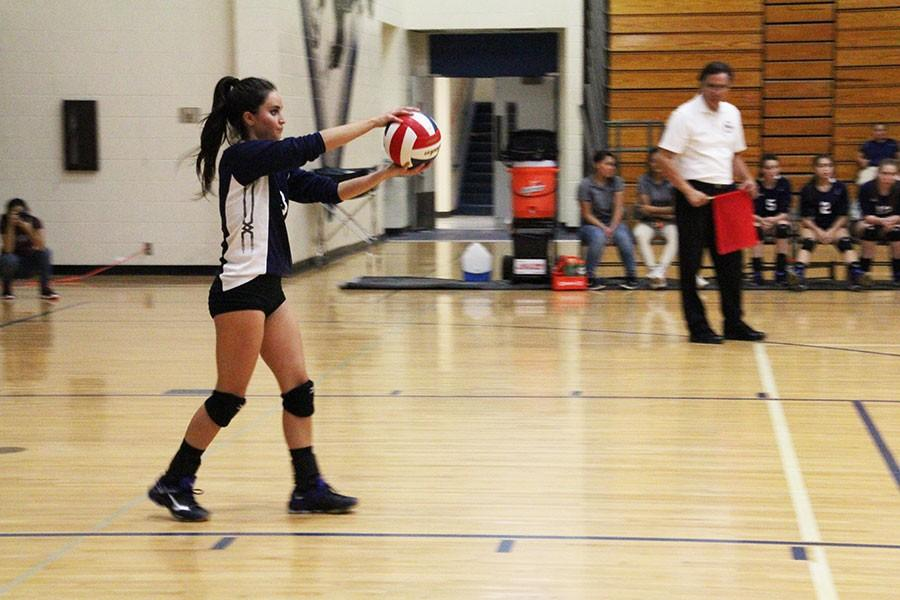 Varsity volleyball team member Kayla Dubrule serves the first ball against San Elizario, Sept. 8.
