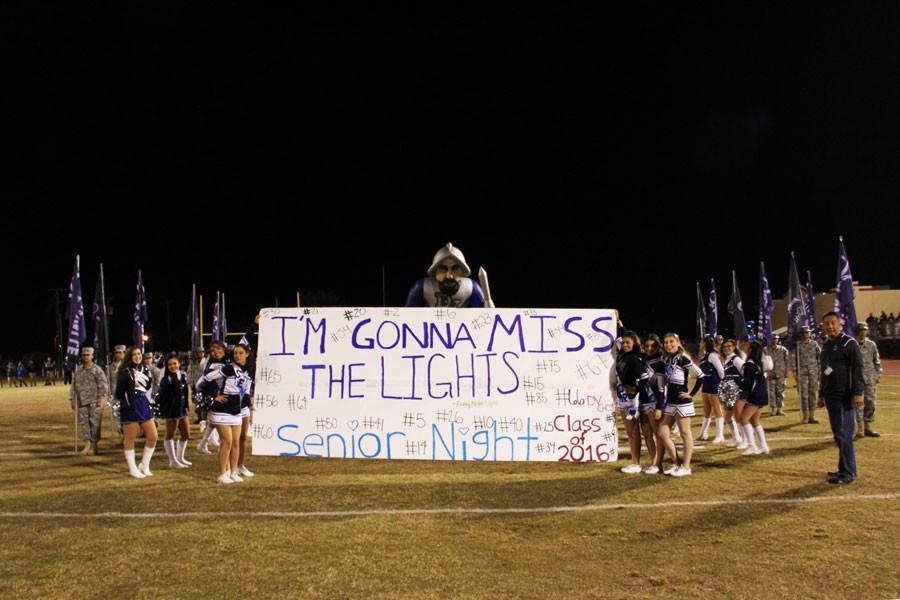The Varsity Cheerleaders present a banner onto the field on Nov. 6 at Senior Night.