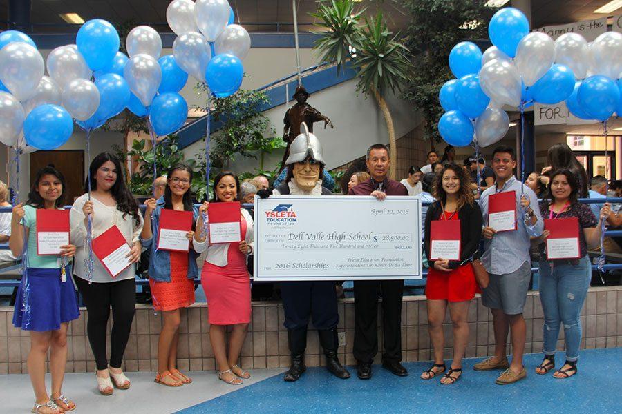 Scholarship recipients Rocio, Alejandra, Alexa, Evelyne, Katrina, Cristian, and Jasmine and Principal Antonio Acuna at the third round of scholarship awards.