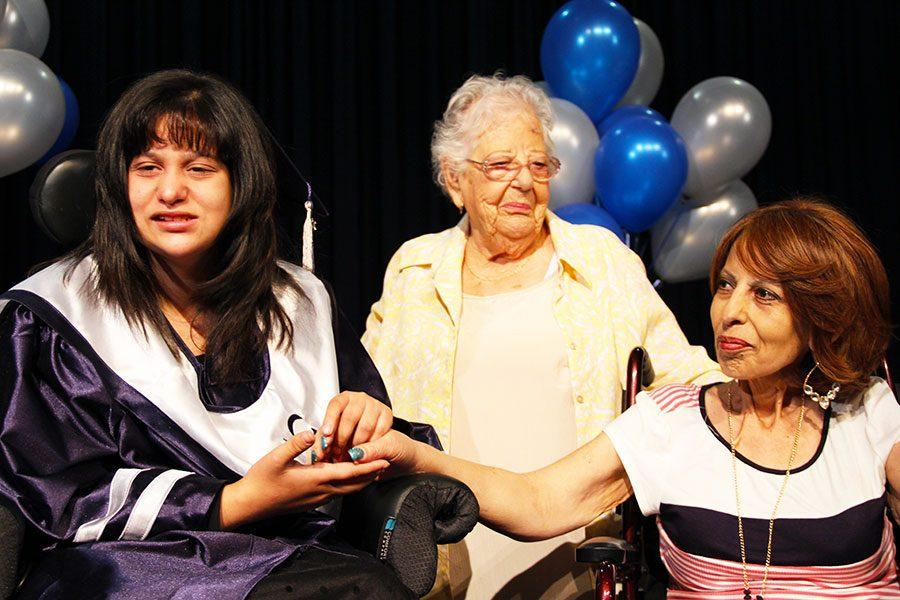 Graduate Jackie Avalos along with her mother and grandmother at a special graduation ceremony.