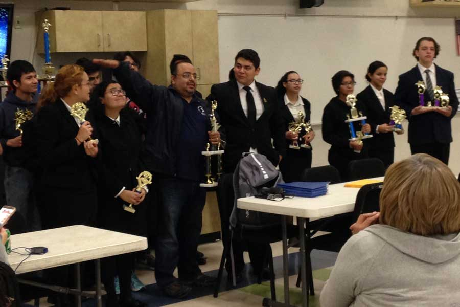 The Debate team with their awards.