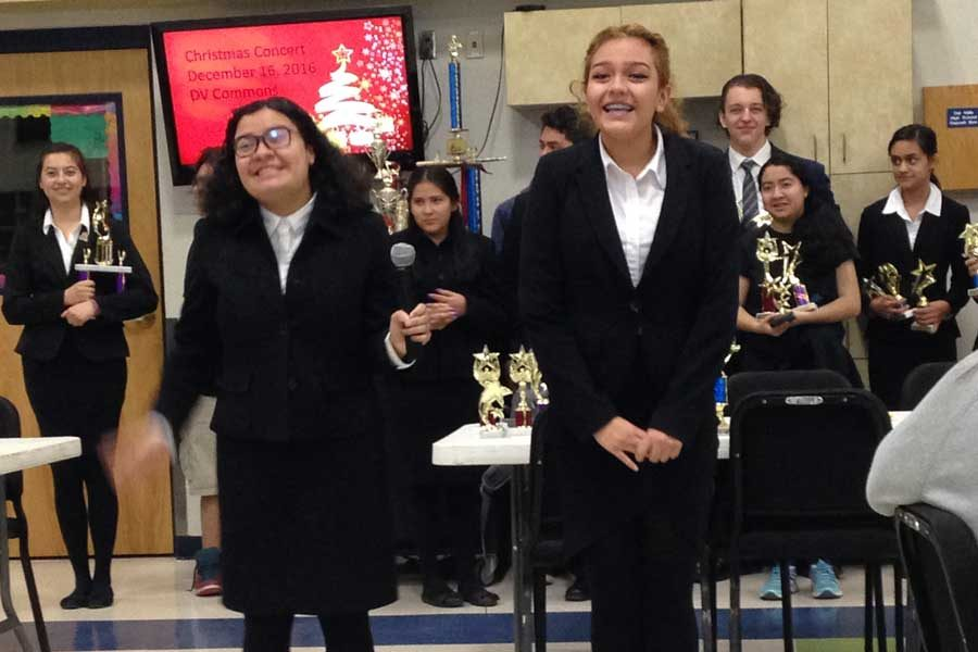 The debate team performs as they receive their awards.