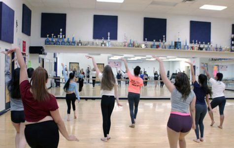 Conqurettes dance through practice to make perfect