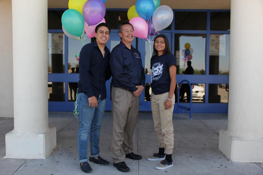 Homecoming queen and king with Principal Antonio Acuna