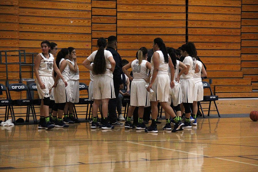 Team huddles up during a timeout, Dec. 5. The score was 54-48, Parkland High School.