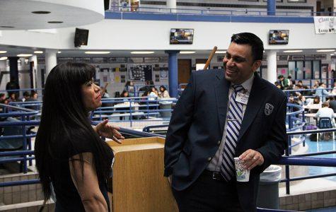 Chemistry teacher Josefina Zamora congratulates new assistant principal Victor Lara.