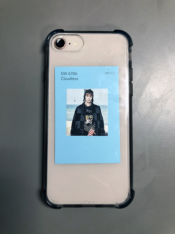 A+BTS+fan%27s+phone+case%2C+featuring+a+picture+of+BTS%27s+Kim+Taehyung%2C+also+known+as+V.