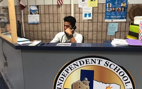 Student employee Caleb Molinar works at the front desk.
