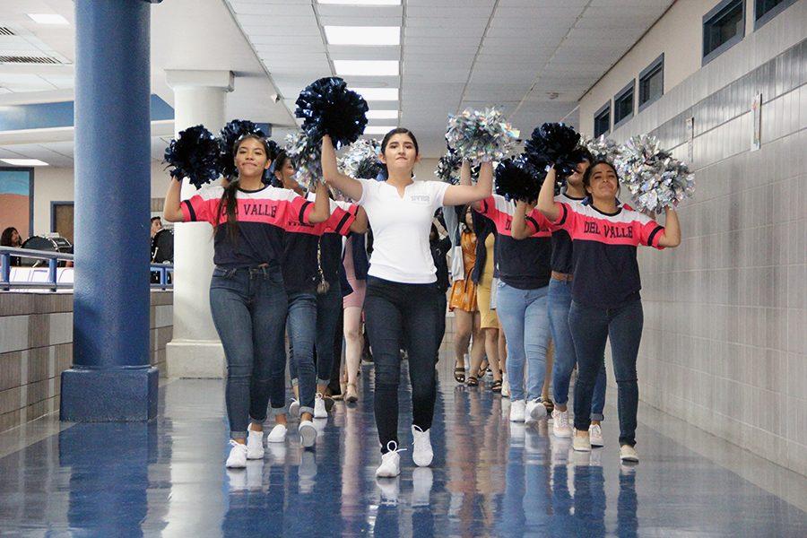 Natalie Moreno (Left Cheerleader) Valeria Hernandez (Middle Cheerleader) Ida Rodriguez (Right Cheerleader) lead the march.