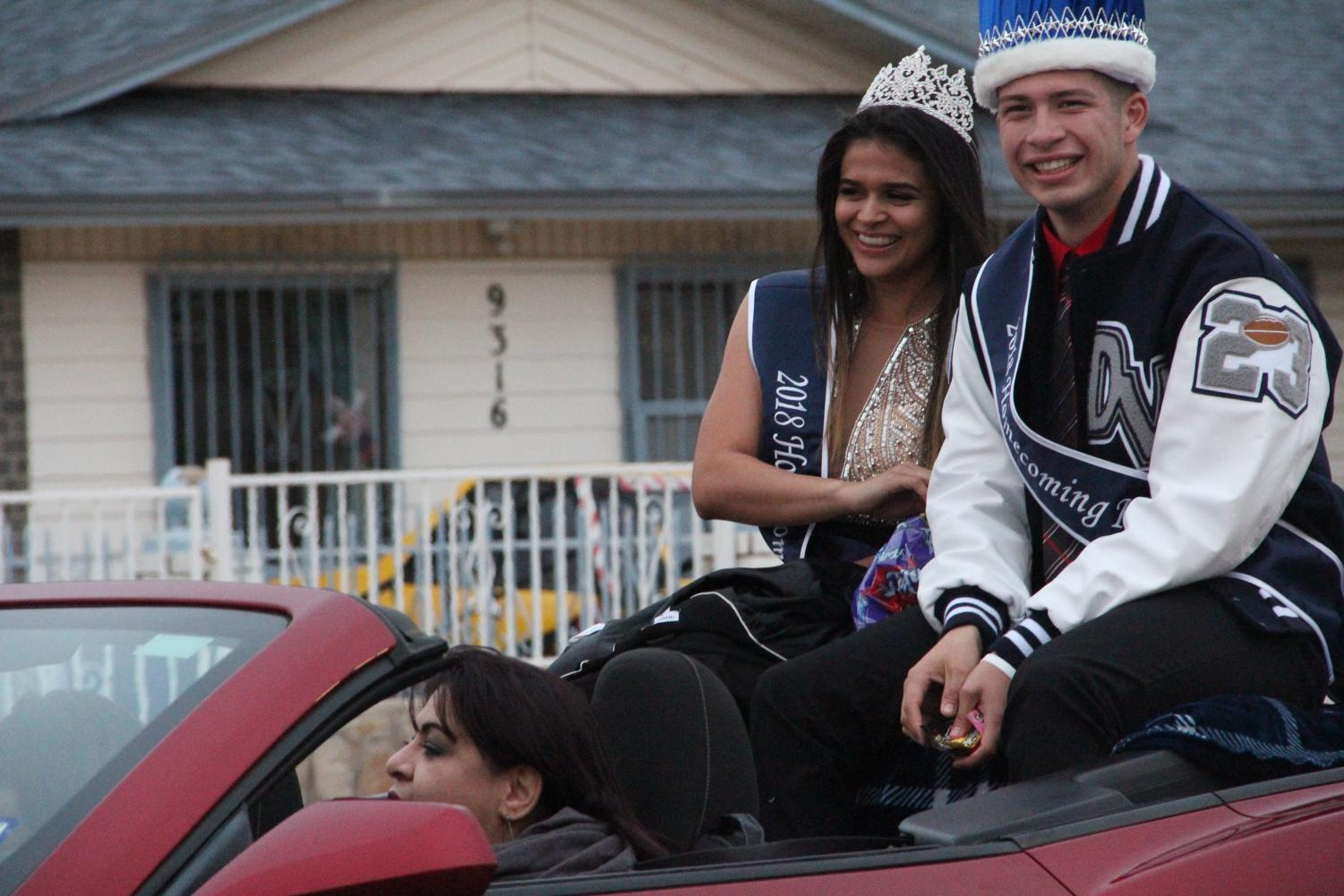 Homecoming queen Love and king Roman wave to the crowd at the homecoming parade.