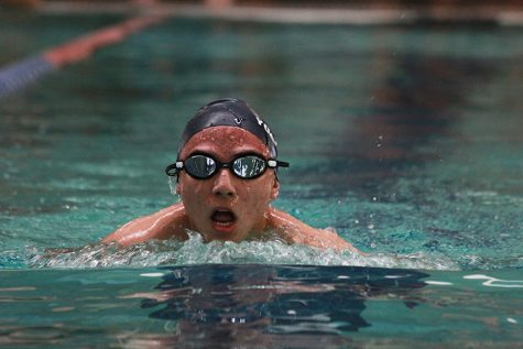 Jorge gasps for air as he competes in the breaststroke.