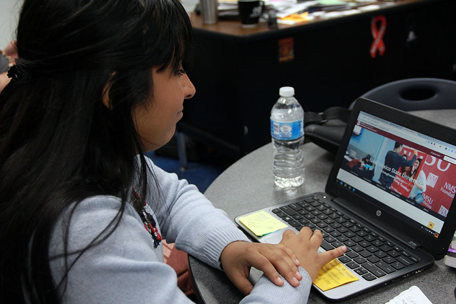 Senior Mildred works on her application to New Mexico State University in the Go Center.