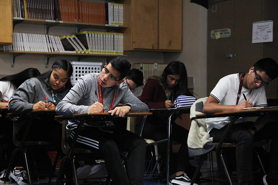 Sophomores Abel,Alan, Daisy and Rani taking notes in Rangel's AP world history class.