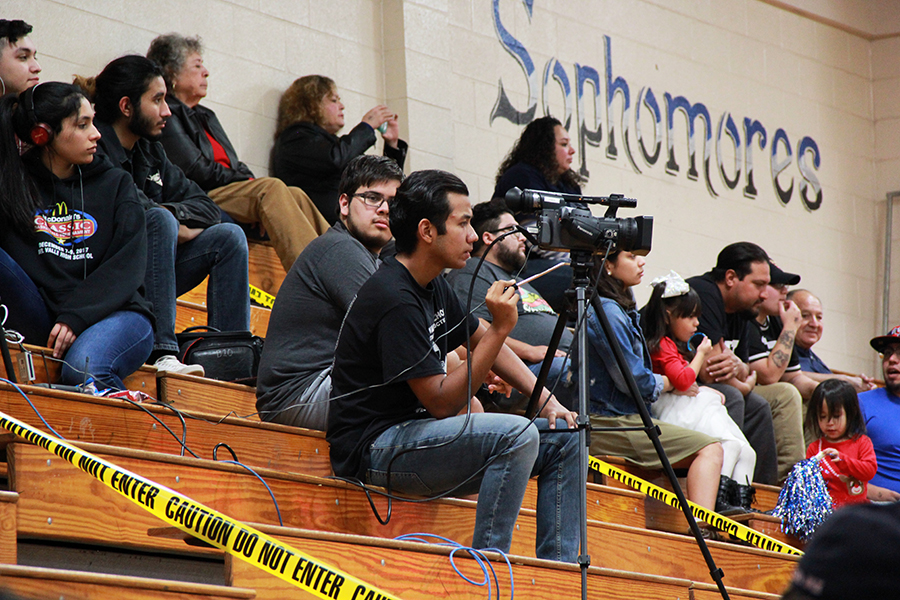 Marco operates the camera during the MacDonald's Classic Basketball Tournament, Dec. 7, for the Conquest Journal livestream.