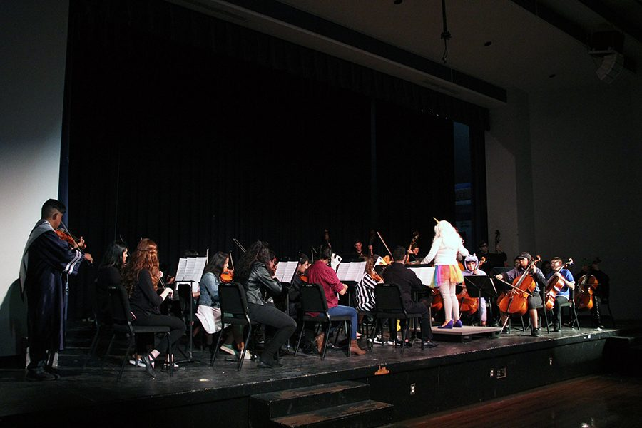 Varsity Orchestra performs a mix of different Halloween songs from scary movies.