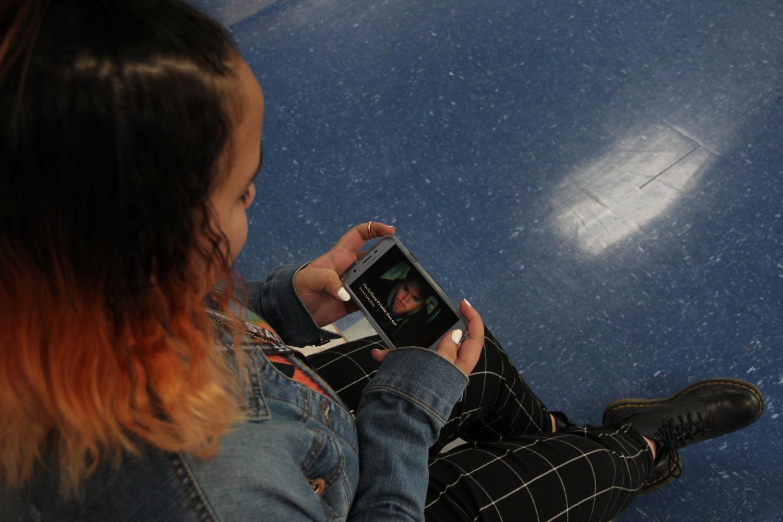 Marisa Garcia watches Shane Dawson's latest video.