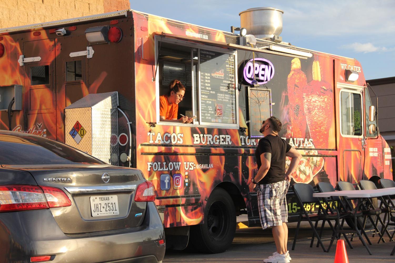 Customer orders from Gavilan Grill food truck.