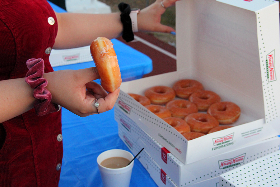 Donuts+and+coffee+is+served+for+the+seniors.