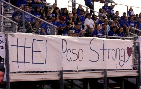 #ElPasoStrong poster displayed during a football game.