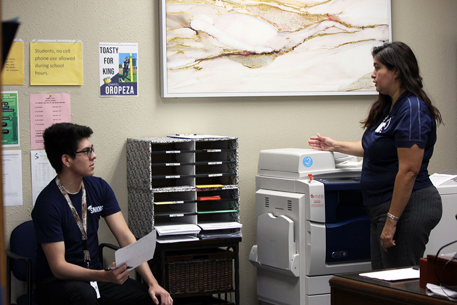 Senior Victor Vasquez asks counselor Leticia Rodriguez for schedule advice.