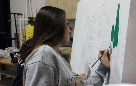 Senior AP art student, Jaqueline Monreal, painting for the Dia De Los Muertos project.