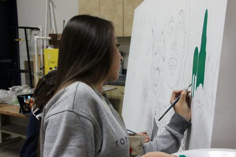 Senior AP art student, Jaqueline Monreal, painting for the Dia De Los Muertos project.