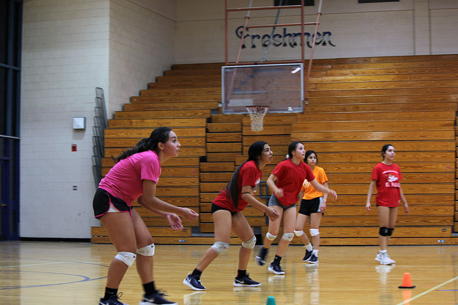 Varsity volleyball team practice hitting the ball, Sept. 26.