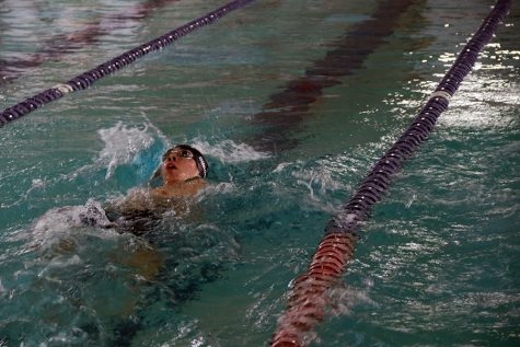 Conquistadore competes in the swim meet at William W. Cowan Swimming Pool.