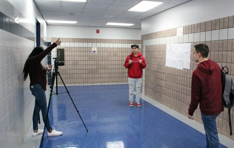 Conquest Journal members Alan Zapata, Aaron Forti, and Destiny Tijerina work on a film