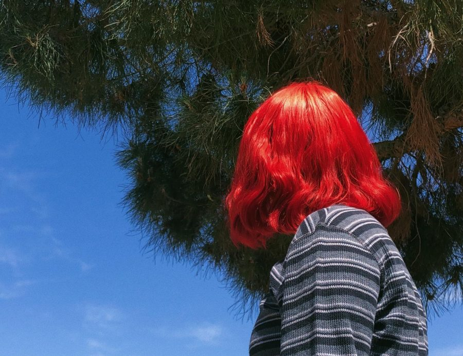 Junior Citlali Viramontes shows her red hair done at home.