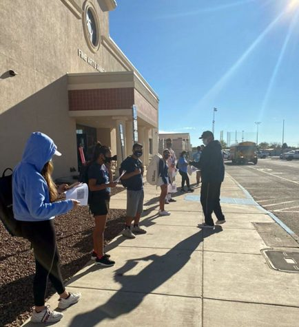 The tennis team waits to be tested for coronavirus before the area match, Oct.  29.