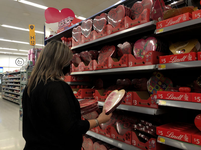 Walmart customer picks out chocolates for Valentine